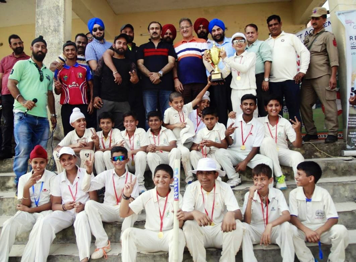 Winners of Jammu Cup Under-14 Cricket Tournament posing along with chief guest and other dignitaries on Wednesday.