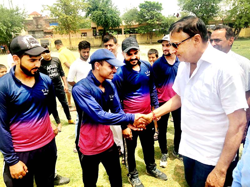 Former Minister and BJP leader Sham Lal Sharma interacting with players during inaugural ceremony of the final match at Jourian on Friday.