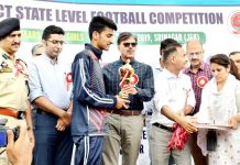 Advisor K Vijay Kumar felicitating winners during concluding ceremony of 'Let's Play' Football Tournament in Srinagar.