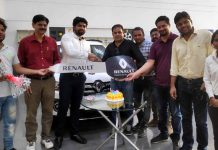 Officials of Red Chief handing over the key of Renault Kwid to its lucky customer Lovneesh Gautam at Ghaziabad.