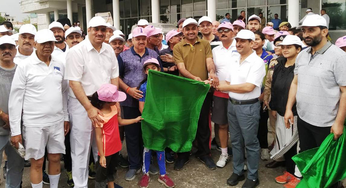 Runners being flagged off during International Walkathon at Jammu University on Wednesday.