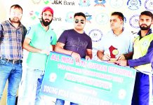 Winner receiving man of the match award during Gufran T20 at Sports Stadium in Doda.