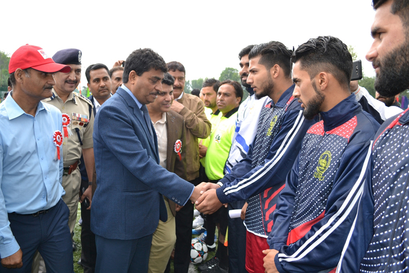 Financial Commissioner Dr A K Mehta interacting with players while inaugurating Football Tournament in Srinagar on Tuesday.