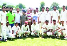 Teams posing for a group photograph along with organisers and officials at Sports Stadium in Poonch.