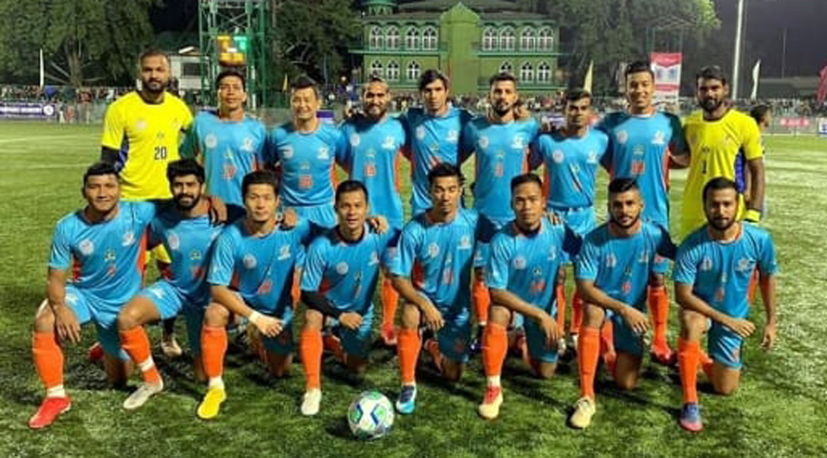 Indian Star XI team posing for a photograph after historic football match under floodlights in Valley.