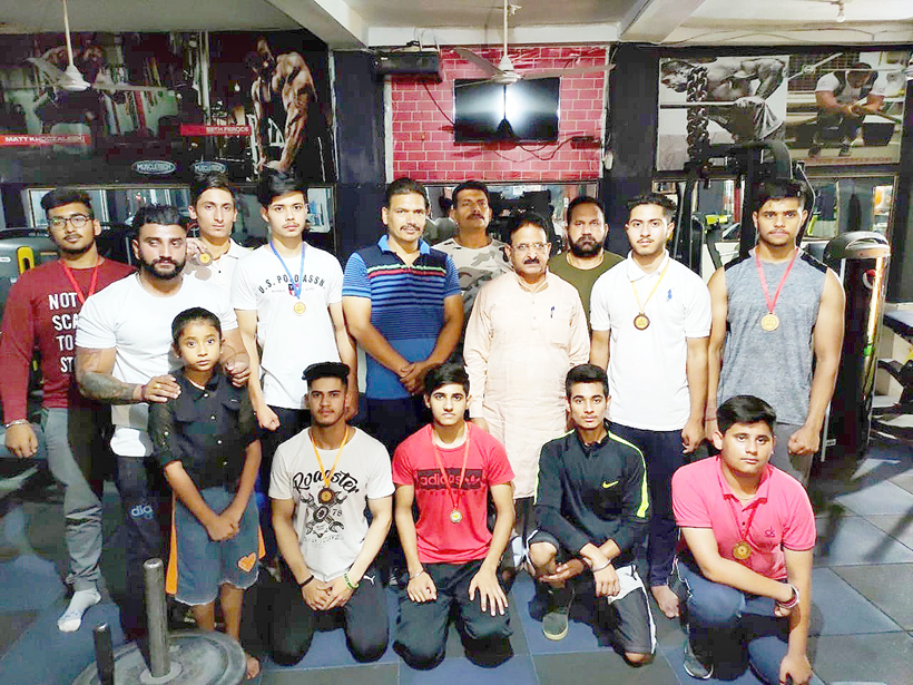 J&K Sports Powerlifting team posing for a group photograph during felicitation function.