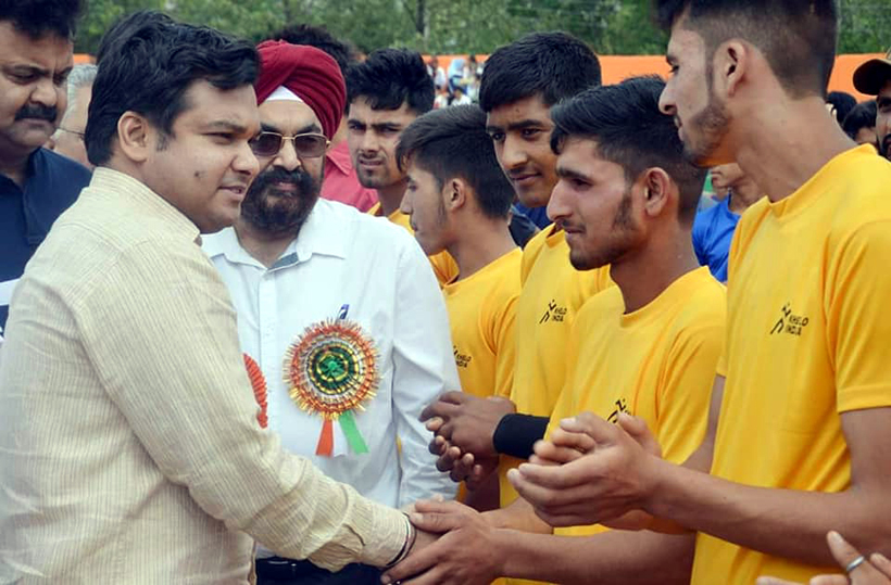 DDC Udhampur, Dr Piyush Singla interacting with players at Subash Stadium in Udhampur on Tuesday.