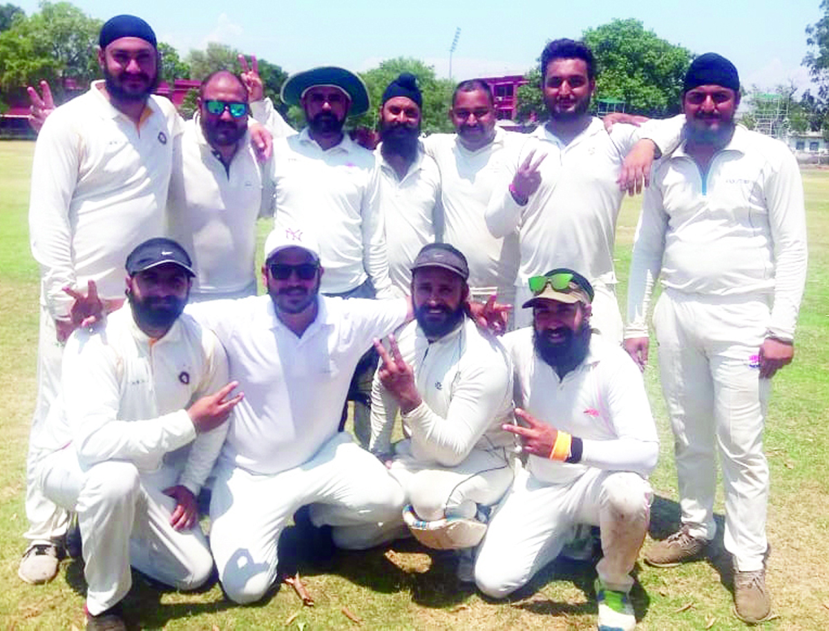 Players of Virat Cricket Club posing for a group photograph after registering big win over Rebellion Club in Jammu.
