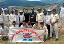 Players of jubilant Doda Warriors Sports Club posing for a group photograph after scripting big win at Bhaderwah.