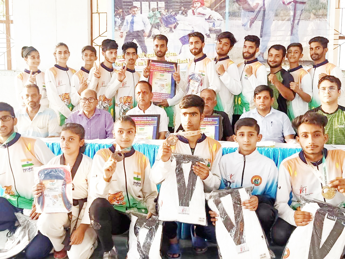 Medals winners and other members of State Taekwondo in Jammu on Wednesday.