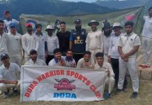Players of Doda Warriors Sports Club posing for a group photograph after scripting big win at Bhaderwah.