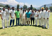 Officials pose with winning team of NS Bedi Club at Sports Stadium, Poonch on Tuesday.