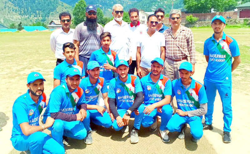 Young cricketers of Bhaderwah Cricket Academy posing along with DG Sports Dr Saleem-ur-Rehman and other dignitaries at Bhaderwah.