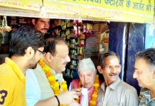 NC President Farooq Abdullah along with Devender Singh Rana at a local tea stall in Jammu on Tuesday.