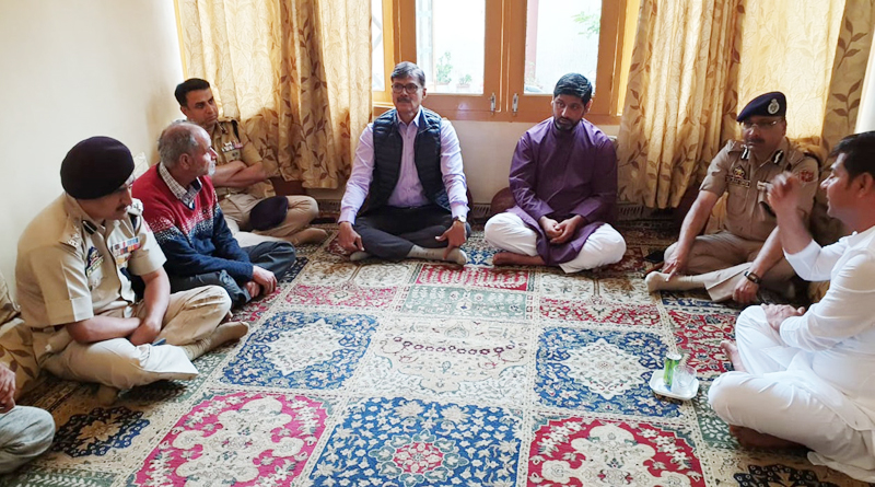 Advisor K Vijay Kumar and DGP Dilbag Singh expressing sympathy with family members of martyr Arshad Khan in Srinagar.