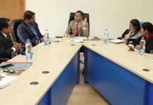 Justice Tashi Rabstan chairing a meeting of district administration at Leh on Wednesday.