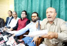 Awami Ittehad Party (AIP) chairman Engineer Rashid and Jammu and Kashmir Peoples Movement (JKPM) chairman Shah Faesal announcing a pre-poll alliance on Tuesday. -Excelsior/Shakeel