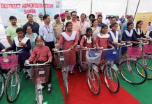 Principal Secretary Industries Navin Choudhary giving bicycles to BPL girls at Samba.