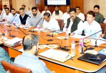 Advisor Khurshid Ahmed Ganai chairing a meeting on Sunday.
