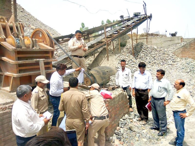 DMO and Tehsildar along with team of officers sealing a stone crusher in Kathua on Wednesday.