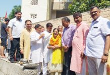 Former Minister, Sat Sharma kick starting construction work of nallah at Shakti Nagar on Wednesday.
