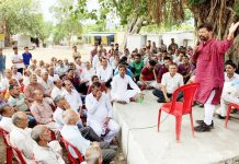 Ch Lal Singh addressing a public meeting at Basohli on Tuesday.