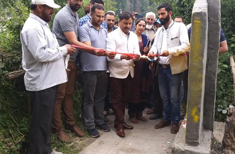 DSW Jammu, Dr Bharat Bhushan laying foundation stone of a drain in Nalthi, Bhaderwah.