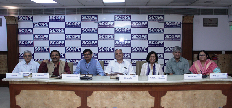 SCOPE executives during a meeting to decide Excellence Awards.