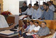 Advisor Khurshid Ahmad Ganai chairing a meeting in Srinagar on Tuesday.