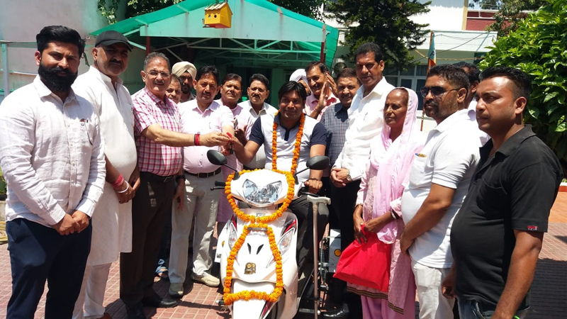 Former DyCM, Kavinder Gupta handing over a scooty to a differently abled person at Langar on Wednesday.