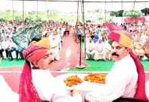 Harsh Dev Singh & others in a public meeting at Ramgarh on Sunday.