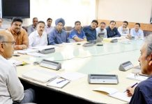Advisor K K Sharma chairing a meeting at Srinagar on Tuesday.