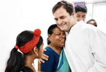 Congress President Rahul Gandhi interacting with Rajamma,a retired nurse from Wayanad,at PWD Rest House Kalpetta on Sunday. (UNI)
