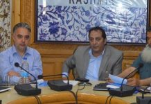 Divisional Commissioner Kashmir, Baseer Ahmad Khan chairing a meeting on Tuesday.