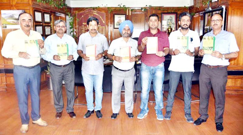 SKUAST-Jammu VC Dr K S Risam and others releasing a set of books on Friday.