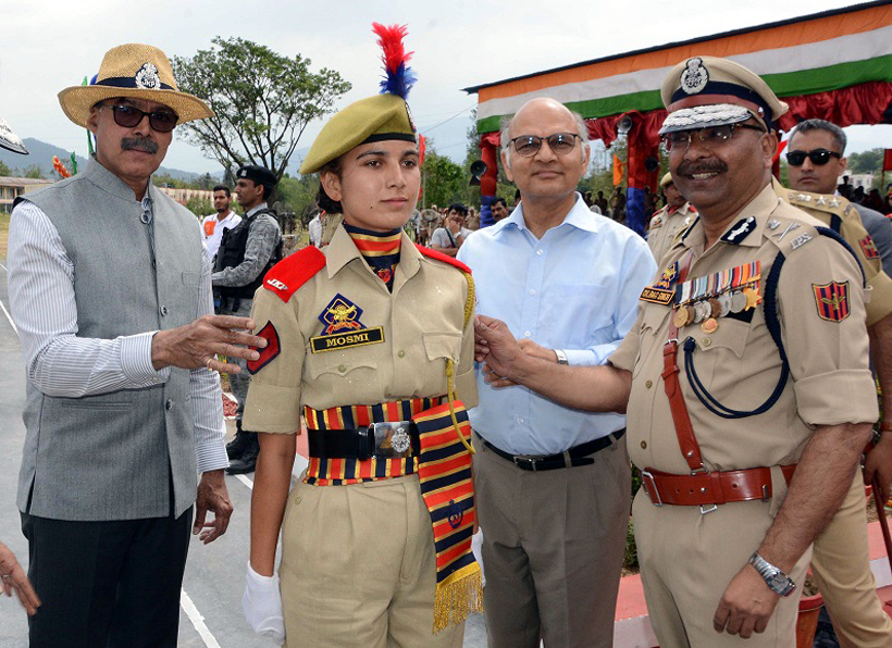 Advisors K Vijay Kumar, K K Sharma and DGP Dilbag Singh decorating a newly passed out lady cop at SKPA Udhampur.