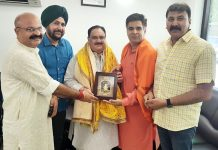 BJP State leaders led by Ravinder Raina presenting a memento to national working president of party J P Nadda at New Delhi on Saturday.