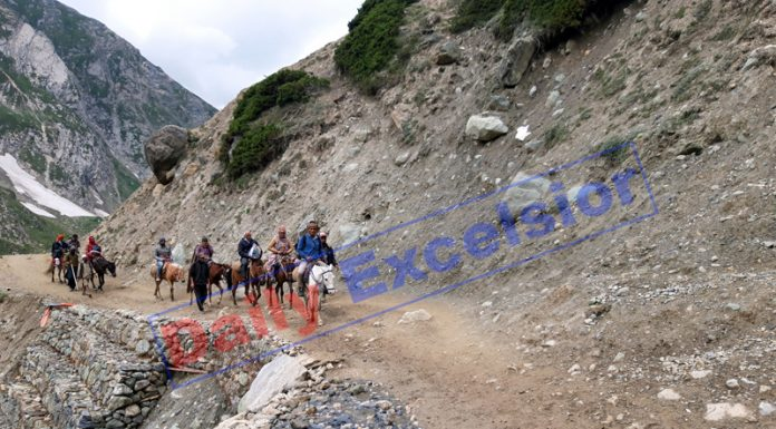 Amarnath Ji yatris on way to holy cave via Chandanwari track on Monday. -Excelsior/Sajjad Dar