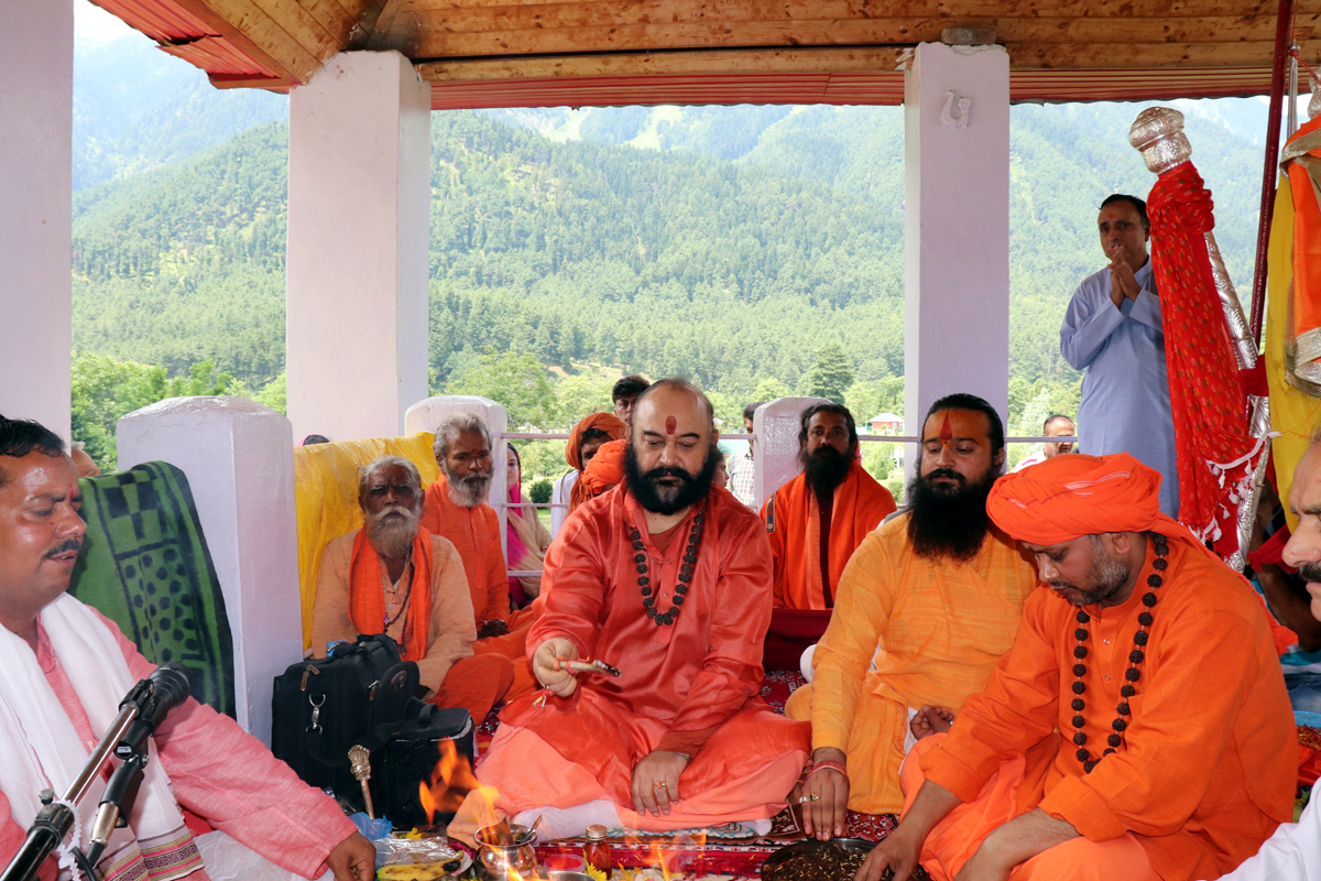 Mahant Deependra Giri Ji and other Sadhus performing Chhari Pujan at Pahalgam on Tuesday. -Excelsior/Sajjad Dar