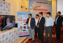 Officials of Videocon on the launch of 'Monsoon Magic' offer on its AI Smart LED TV range in Jammu. -Excelsior/Rakesh