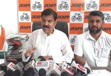 NPP leader Harshdev Singh addressing press conference in Jammu on Thursday.