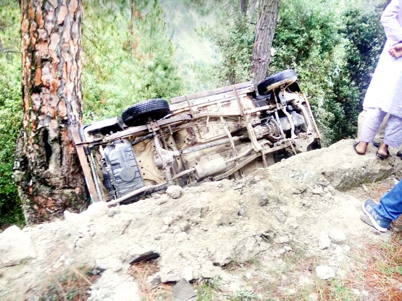 Ill-fated vehicle lying in gorge in Mendhar area of Poonch on Thursday.