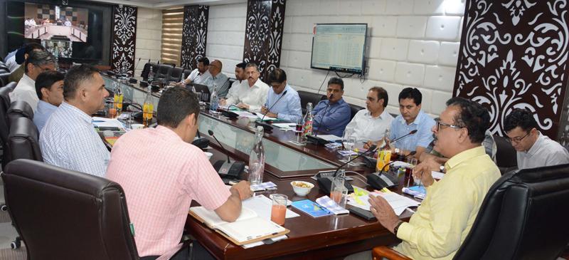 Principal Secretary Industries Naveen Chaudhary chairing a meeting on Thursday.