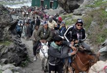 Shri Amarnath yatris heading towards cave shrine. — Excelsior/Sajjad Dar