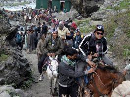 Shri Amarnath yatris heading towards cave shrine. — Excelsior/Sajjad Dar