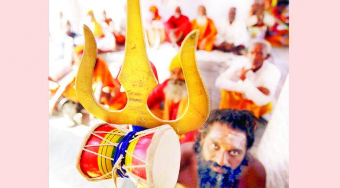 A Shri Amarnath bound Sadhu at Ram Mandir Purani Mandi displaying 'Trishul and Damroo' on Sunday. -Excelsior/Rakesh