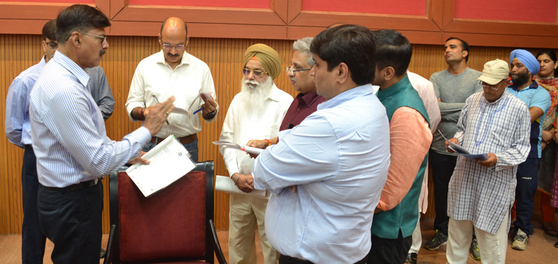Advisor Vijay Kumar interacting with a delegation at Convention Centre, Canal Road Jammu on Tuesday.