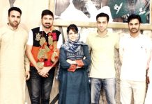 Former Chief Minister, Mehbooba Mufti posing for a photograph with youth activists of party at Srinagar on Tuesday.