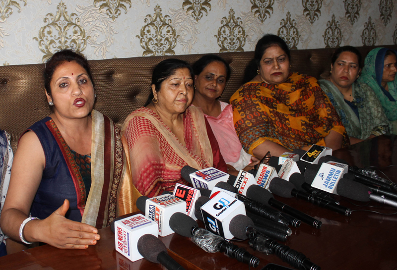 Anganwadi Workers & Helpers Union President, Suman Suri addressing press conference in Jammu on Thursday. -Excelsior/Rakesh