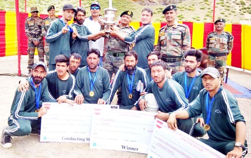 Commandar Drass Warriors, Brigadier V Ganapathy presenting T20 title trophy to NSC Bhimbat at Drass in Kargil. -Excelsior/Basharat Ladakhi